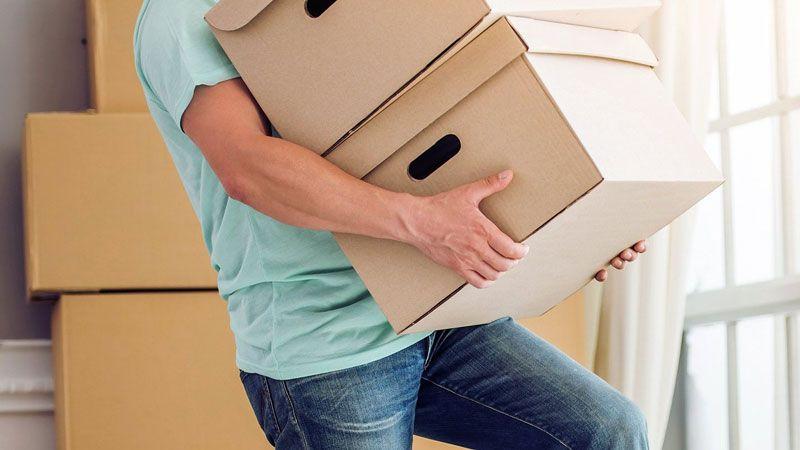 Khuân vác nặng dẫn đến bệnh thoát vị đĩa đệm cột sống thắt lưng